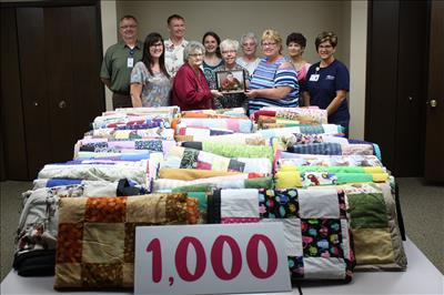 Pictured above, United Hospice Service staff pose with Brenda Miller, her family, and members of Charlie's Angels Quilting Group. Pictured above left to right is John Carlson and Shelli Greschaw of United Hospice Service, Terry Kiehl, Shirley Scott, Heidi Miller, Pam Kern, Sharron Hartwick, Brenda Miller, and Deb Schell and Rennae McKenney of United Hospice Service. There are 17 additional quilt members not pictured.